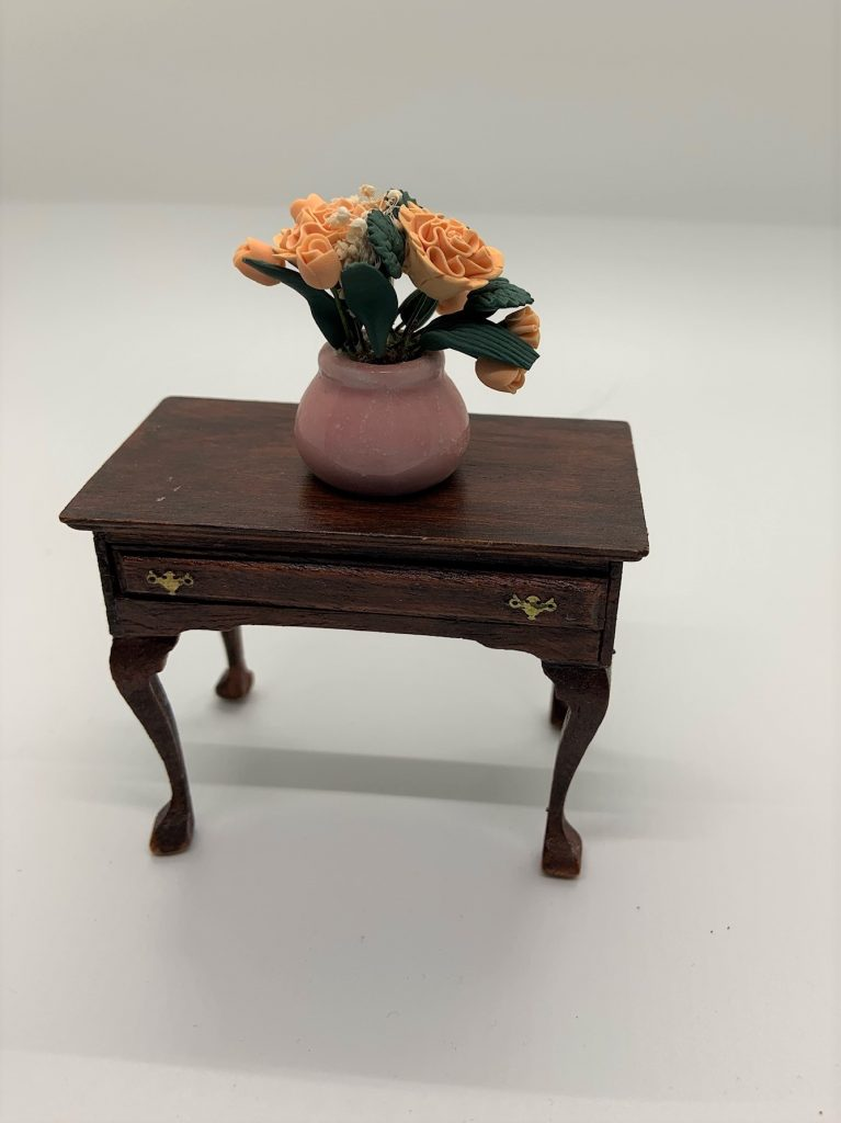 The house of miniatures end table with flowers