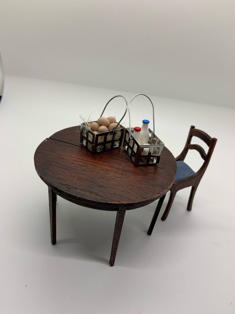 The house of miniatures round table with milk and eggs