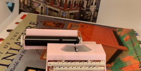 pink miniature typewriter on books