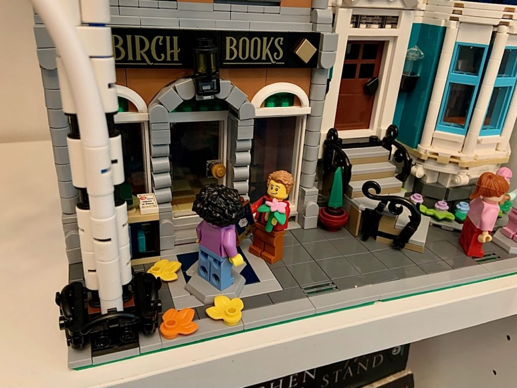 Lego Bookshop with man giving flowers to girl