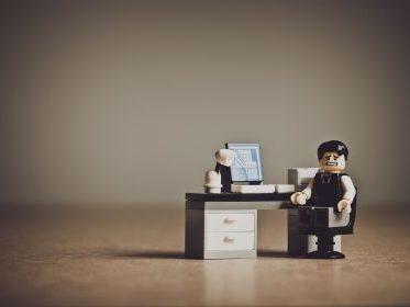 Unhappy lego man at desk
