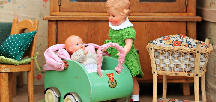 Dollhouse child with baby in buggy