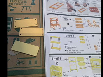 Picture of instructions and wood items from the greenhouse kit