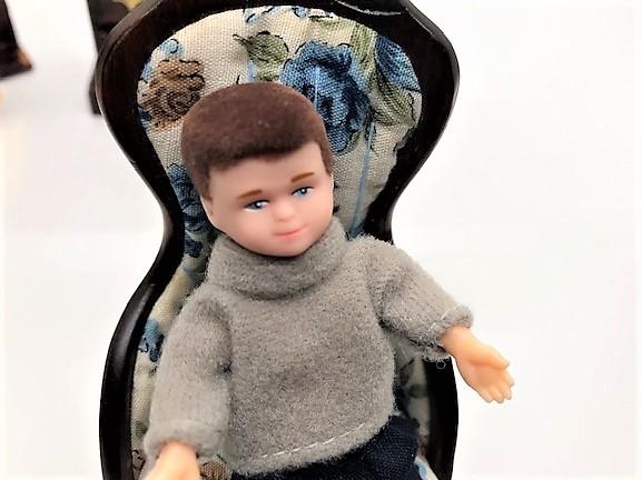 boy doll in chair