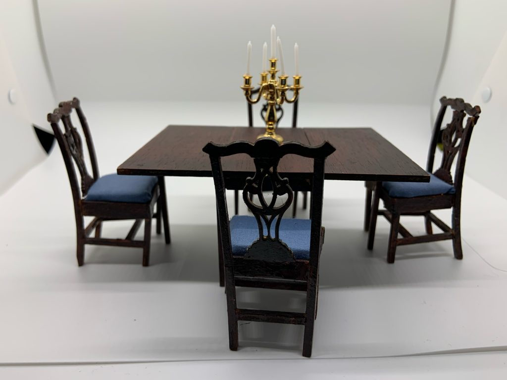 The house of miniatures dining table with candelabra